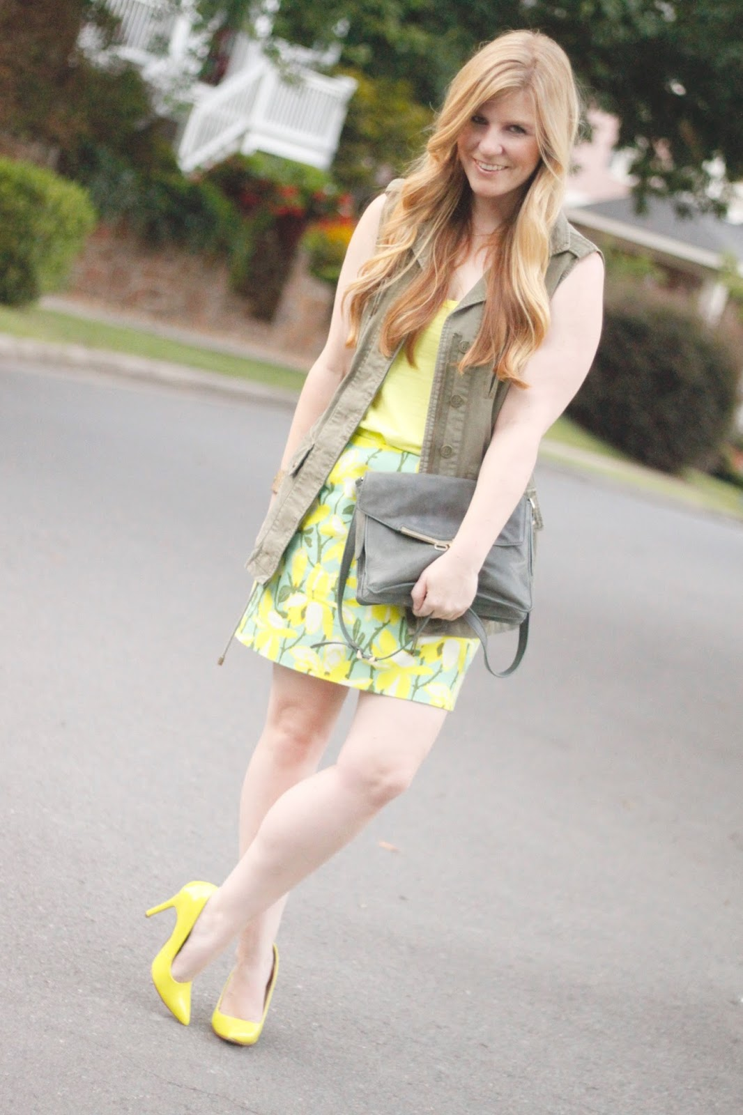 olive green military vest with neon heels