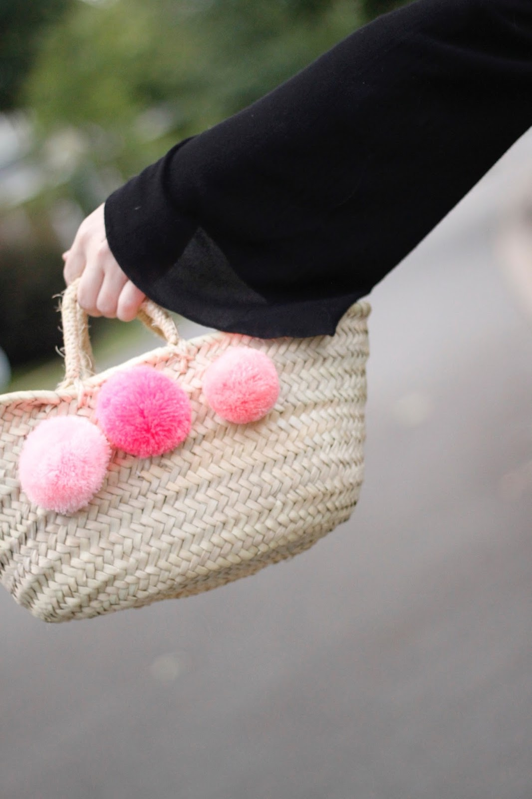 pink pom pom straw bag