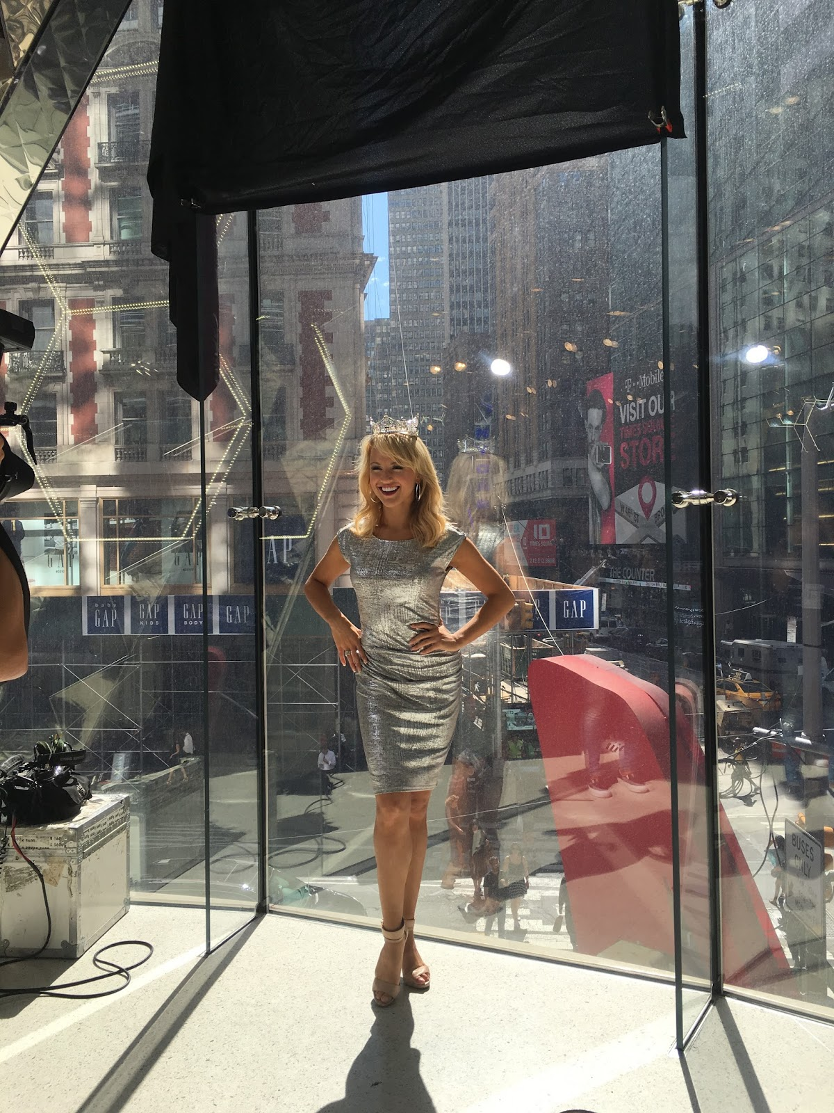 Savvy Shields, Miss America, wears a fitted metallic Joseph Ribkoff dress in NY
