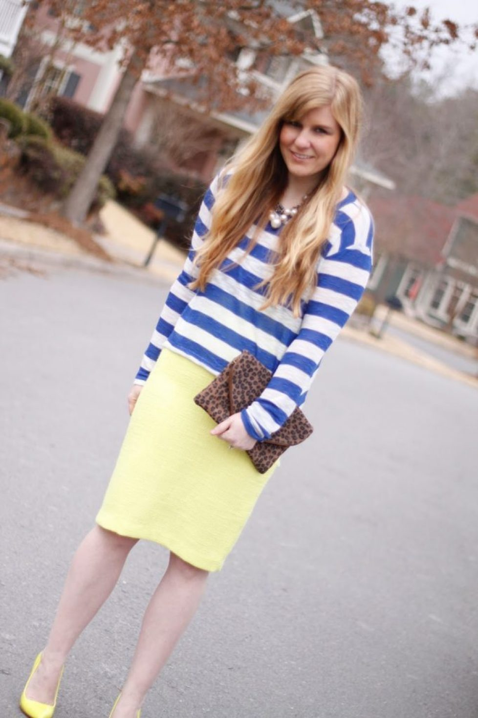 Fashion Blogger Wearing Stripes and Neon Heels