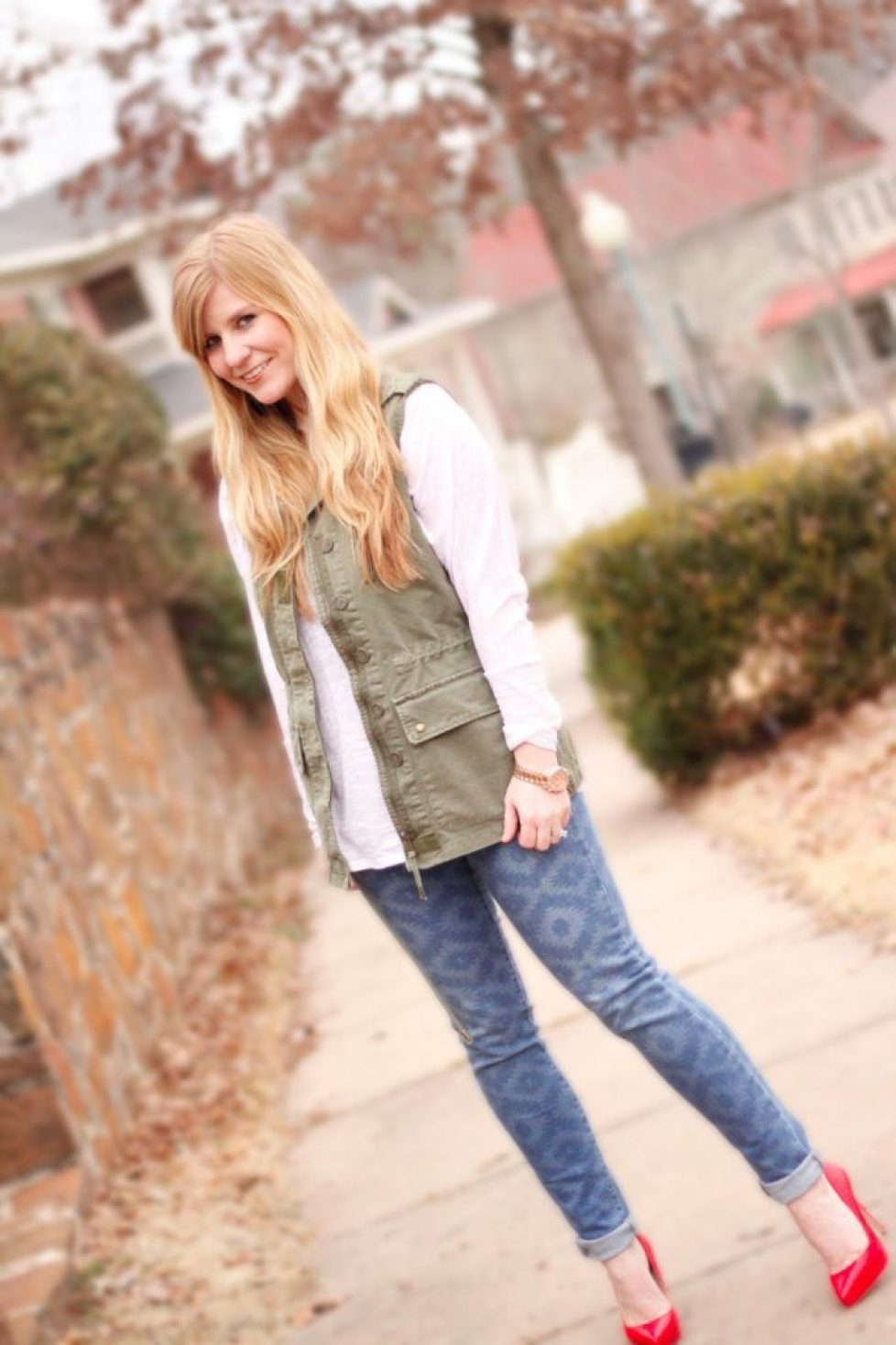 Wearing my favorite Willow & Clay military vest with red heels!