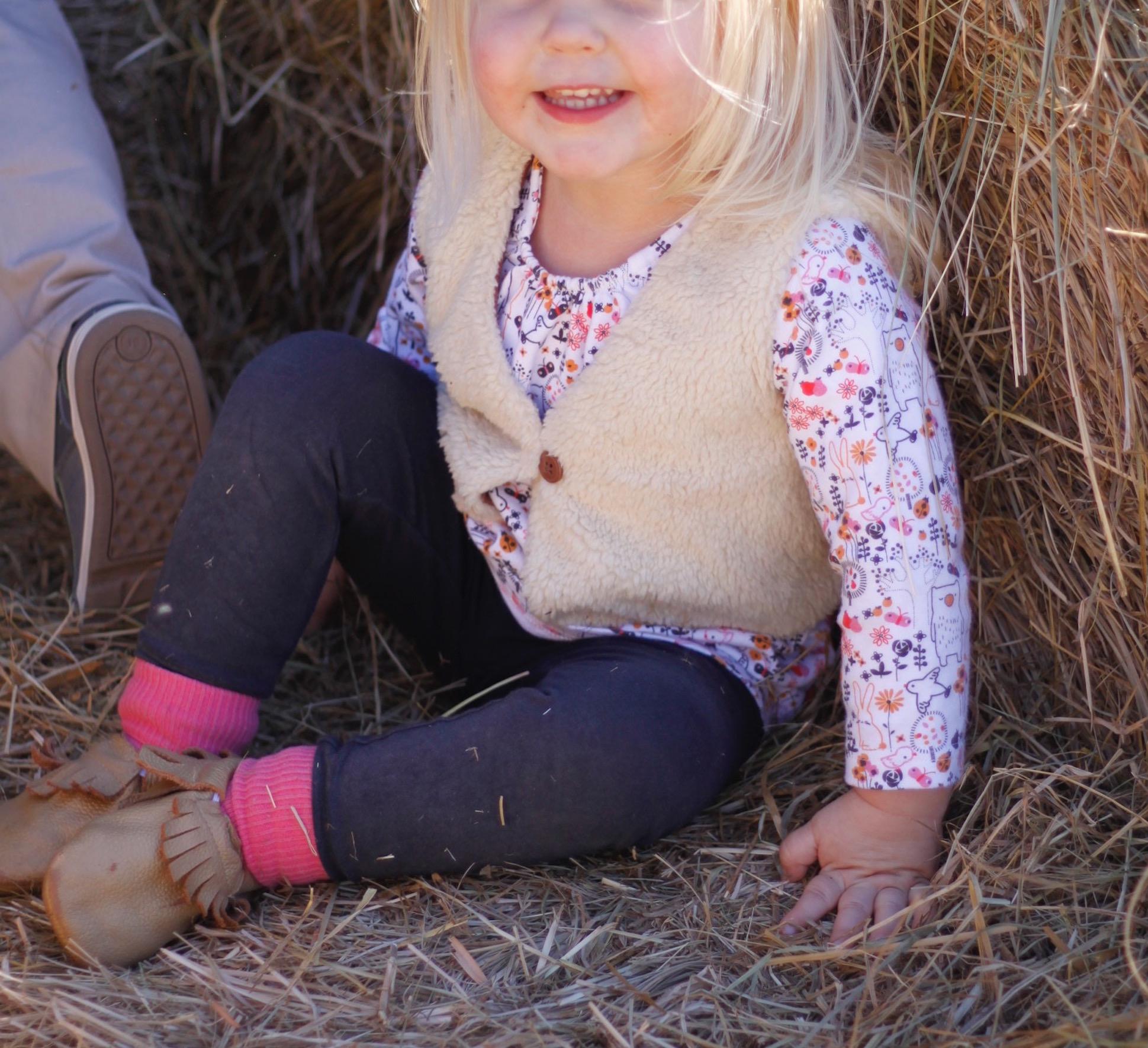 little L wearing zutano faux fur at pumpkin patch